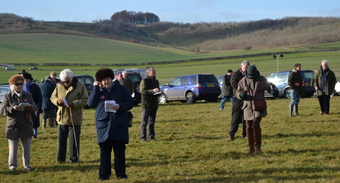 A very familiar figure (centre, glasses) is studying the betting from a distance, it's Point-to-Point Authority Chairman, Simon Claisse