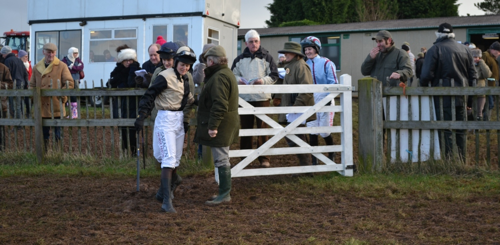 Ally Stirling (light blue silks with maroon seams) chuckles as Jane negotiates the mud