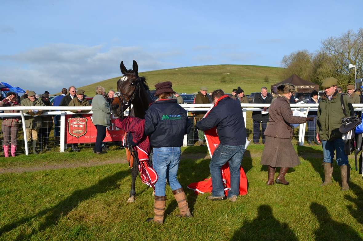 Dai Jones moves in with the winners rug for Hall Kelly