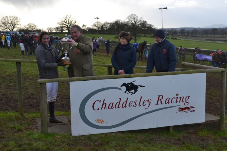 Grand National winning owner John Hales presents Ali Galliers-Pratt with the Marsh Challenge Cup