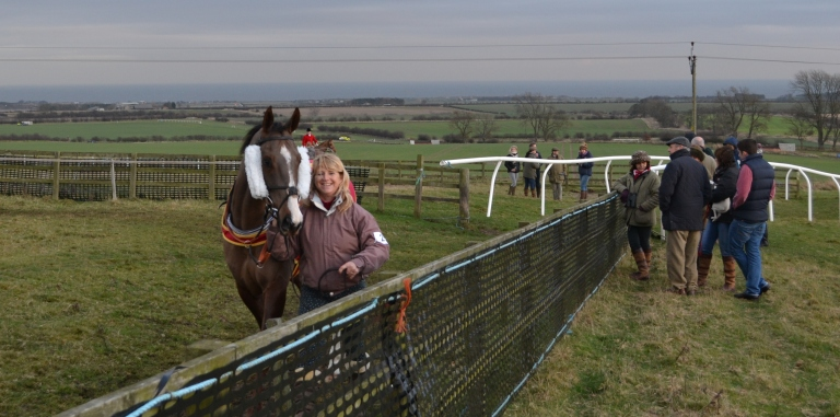 National Hunt trainer Lawney Hill leads up Earl Grez before the Restricted race