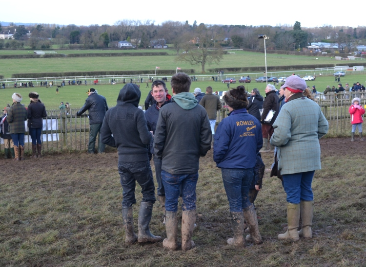 Philip Rowley (facing camera) holds court in the paddock