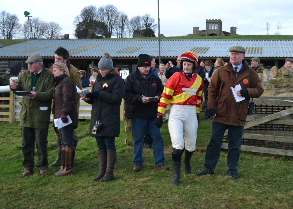 Reigning National Ladies Point-to-Point Champion, Jacqueline Coward, enters the paddock before the ladies open