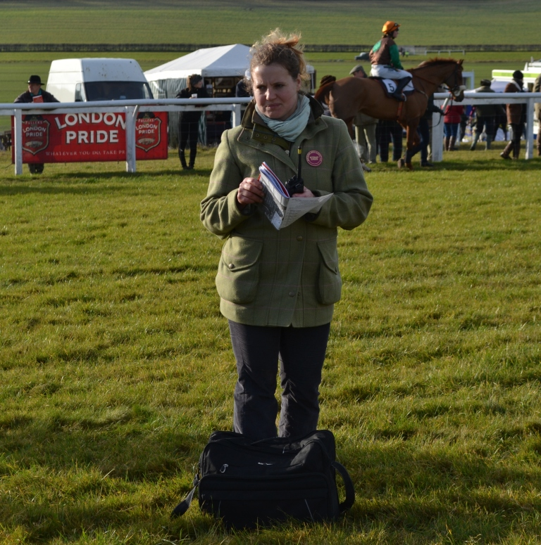 Veterinary surgeon Natasha Seely casts her eye over the runners in the paddock