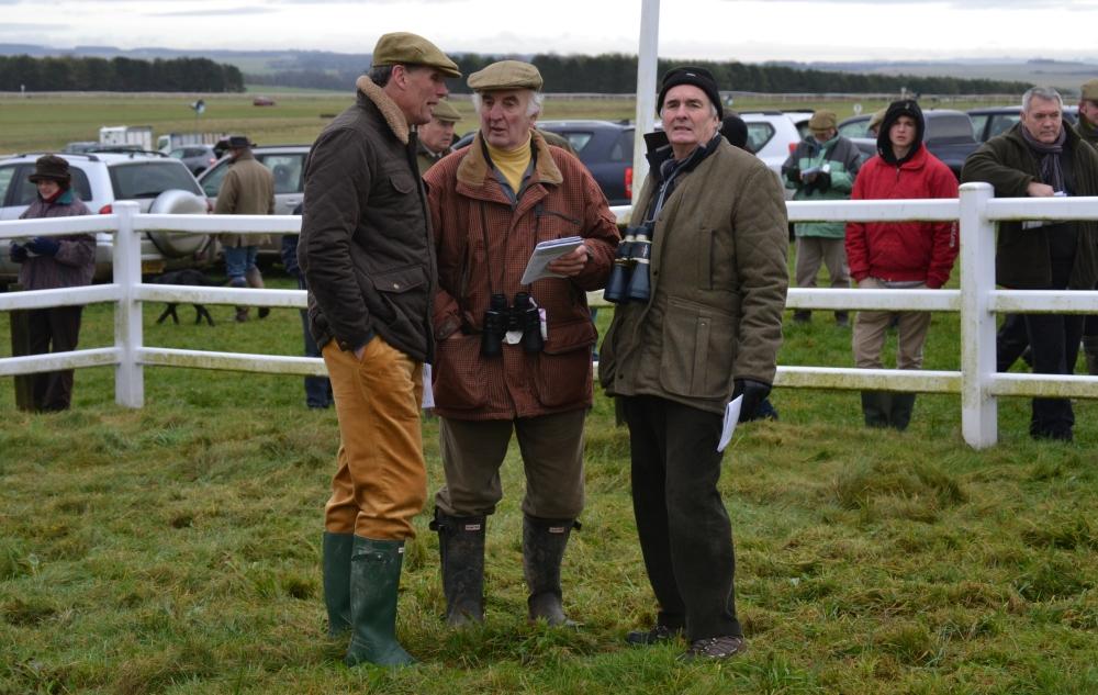 Alan Hill (far left, hands in pockets) enjoys a rare day off
