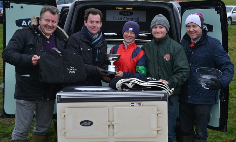 Channel 4 Racing's Nick Luck presents winning rider Catherine Walton with the Brightwells Challenge Trophy, along with David Simpson from AGA (far left) & owners Neil Mechie and Justin Landy