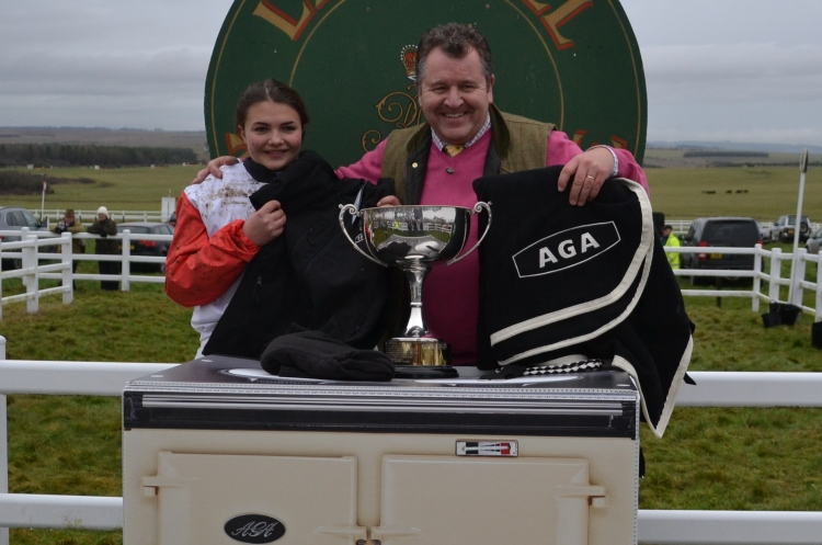 David Simpson (AGA) presents a new AGA rug to Meg Nicholls after she had won the AGA Ladies Open race