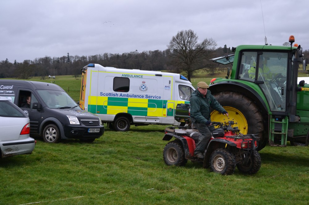 The tractor has just rescued the AGA van from the mud, while clerk of the course James Innes has directed operations from his quad bike