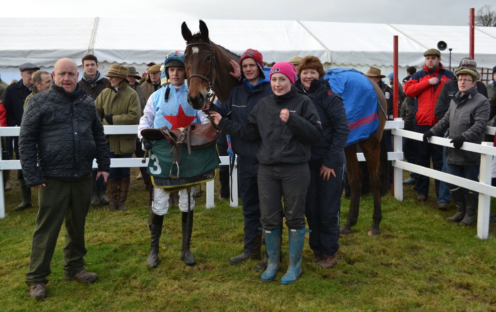 The Dodson & Horrell PPORA Club Members has just been won by Raid Stane and owner/trainer Katie Scott is the second person to appear in the winners enclosure wearing one of THOSE hats!