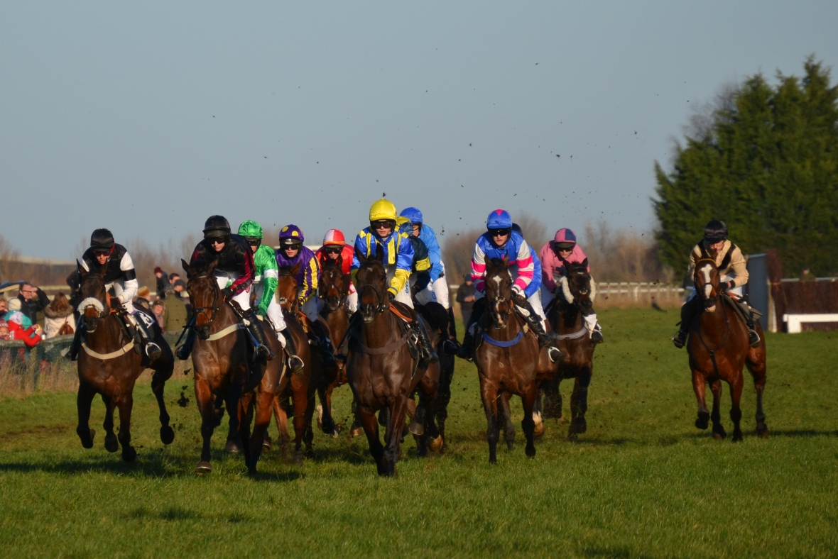 See You Jack (yellow cap) and Now Then Charlie (black) lead the field on the first circuit