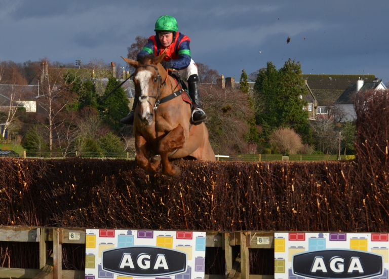 Catherine Walton jumps the last on Ockey De Neulliac in the AGA ladies open race
