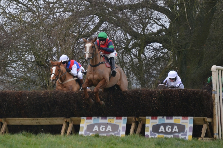 Eventual winner Ockey De Neulliac (green cap) leads on the second circuit of the AGA Ladies Open at Sheriff Hutton