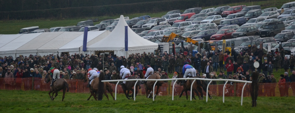 Ockey De Neulliac leads the field out on their final circuit in front of a packed  crowd at Sheriff Hutton