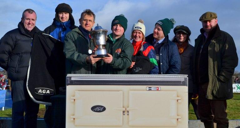 Ron Lillie of AGA presents the Tarquann Trophy to Neil Mechie, along with L-R Alan Davis (AGA), Grant Lillie (AGA), Catherine Walton, Justin Landy, Anne Paxton & Brian Paxton (AGA)