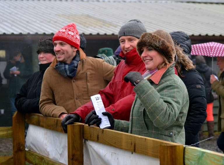 All smiles as Falklander returns to the winners enclosure after winning the Mens Open