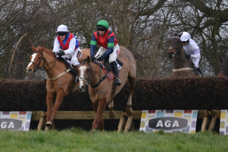 Eventual winner Ockey De Neulliac (green cap) leads Oaklands Robbie on the first circuit in the AGA Ladies Open at Sheriff Hutton
