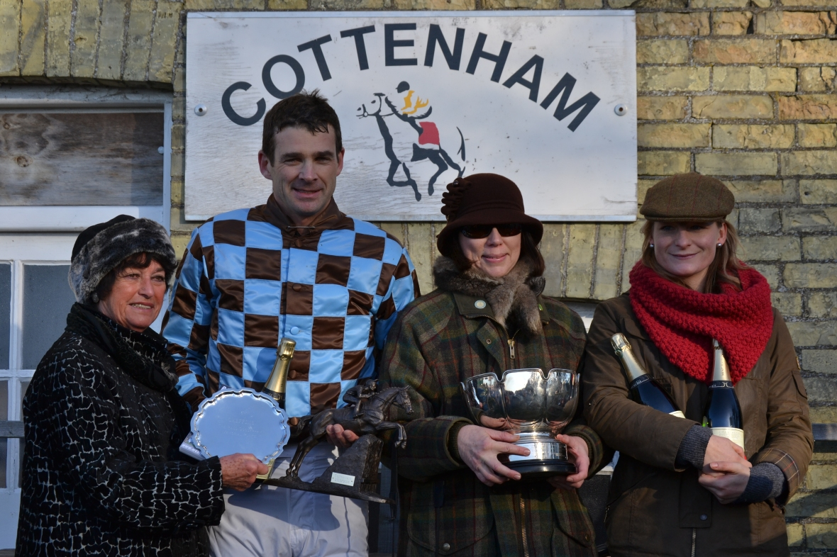 Jockey Stuart Robinson after winning the Mens Open on Brunswick Gold, trainer Rose Grissell (far right) holds onto the bubbly