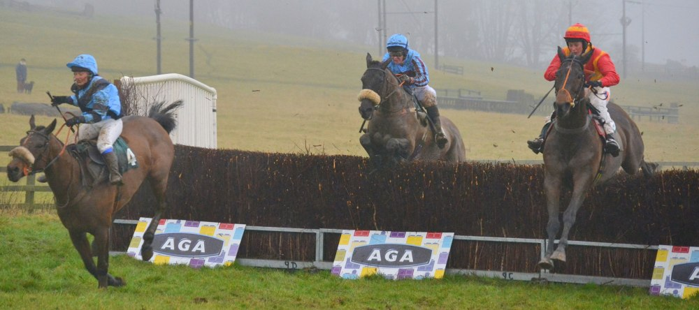 Newyearsresolution (Amie Waugh) far left, jumps the last ahead of Non Dom (Siobhan Doolan) centre, and eventual winner Sacred Mountain (Catherine Walton) in the AGA Ladies Open race