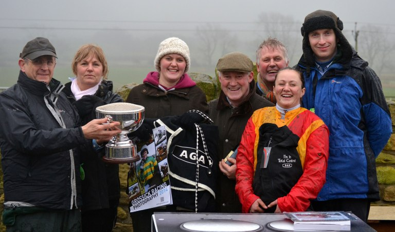 Ron Lillie (far left) and Grant Lillie (far right) of AGA present trophies to the winning connections following the AGA Ladies Open race at Alnwick, which was won by Sacred Mountain (Catherine Walton), also in the photo are L-R: Claire Walton (Catherines mam), Charlotte Walton (Catherine's sister), Jimmy Walton (owner/trainer) and Frankie Walton (owner)