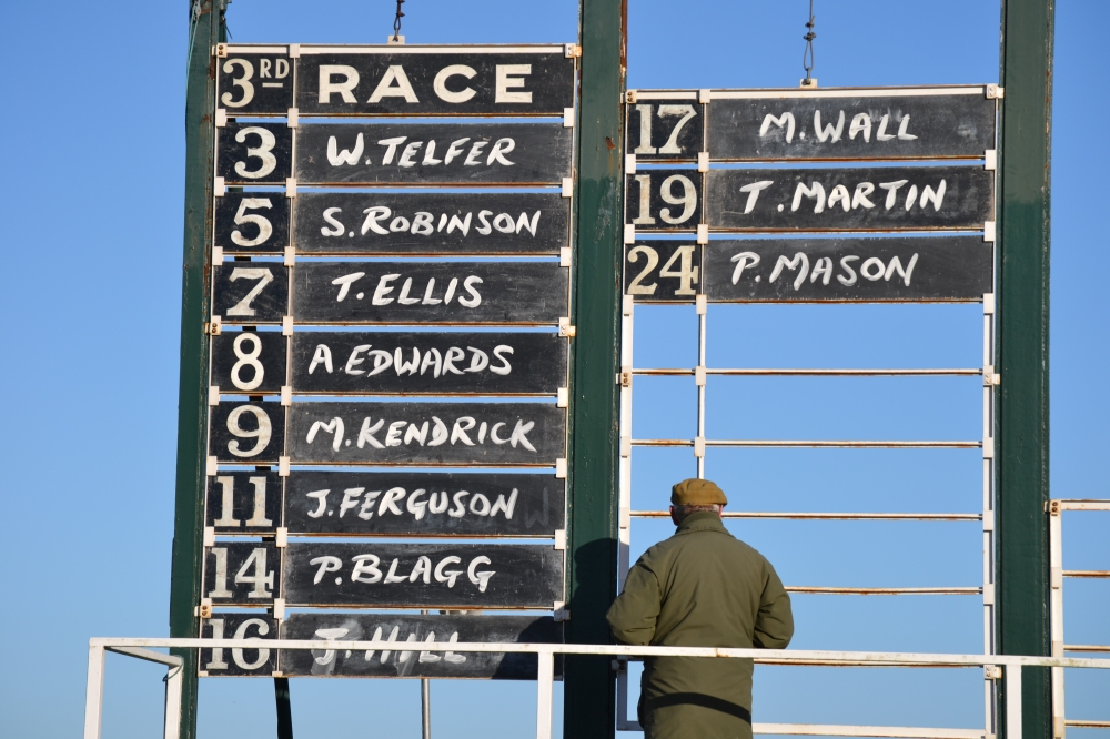 The number board for the Mens Open