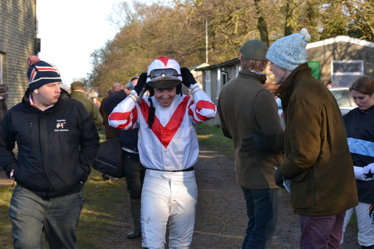Tom Ellis heads out to ride Carlicue in the Mens Open (with some encouragement from Sam Davies-Thomas)