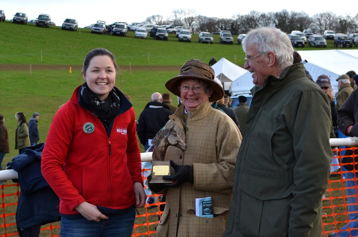 Mr and Mrs A Knox are all smiles as they receive the Humphrey Scott Memorial Trophy from Laura (Connolly's Red Mills)