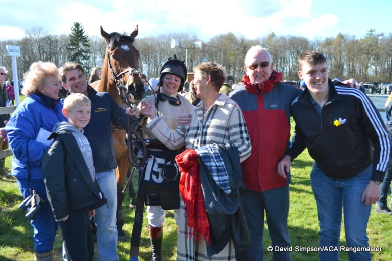 Delight in the winners enclosure for Hannah Lewis, husband Adrian Wintle and connections of Shoreacres