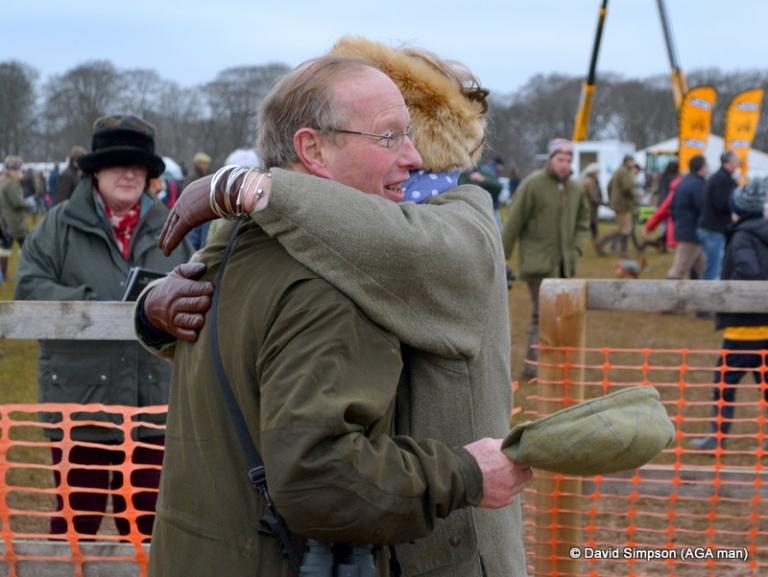 Sara Moule hugs Christopher Marriott after Dabinett Moon had taken the Members race