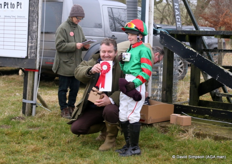 Elliott England receives his rosette and AGA mementoes