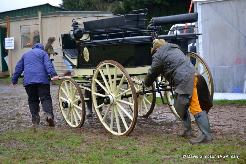 Derek Freathy helps to push the carriage off the course