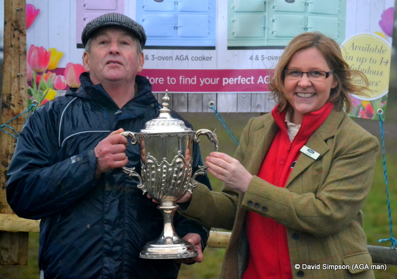 Annmarie Newman from the AGA shop in Kidderminster presents Ken Price with his trophy