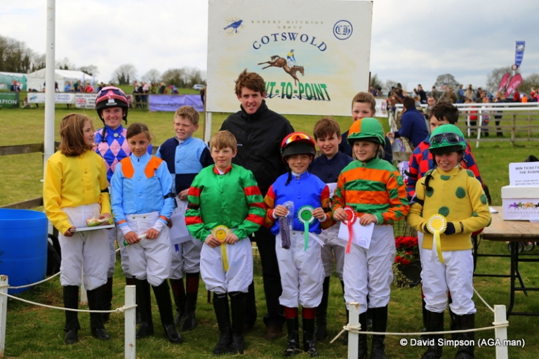 The pony riders line up with National Hunt jockey,  Jason McGuire