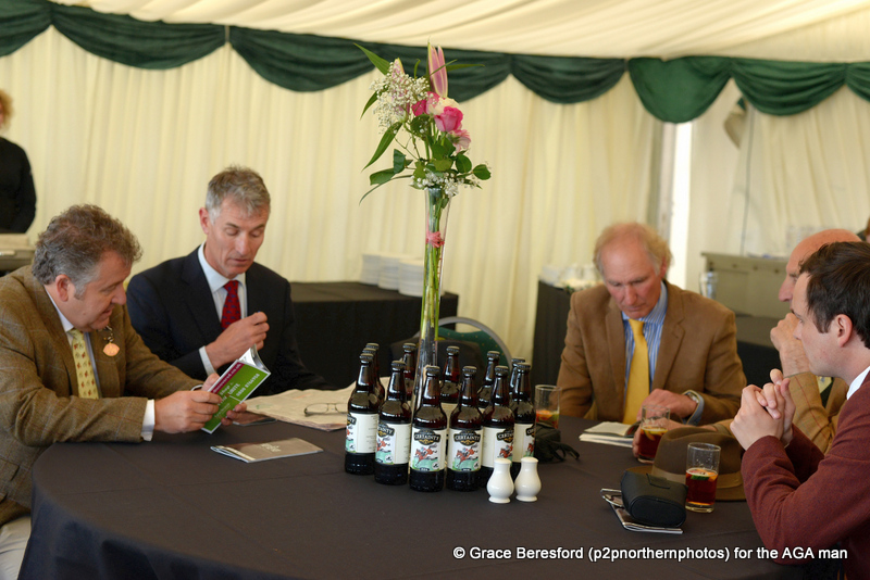 Nigel and Andrew Norman were on course early (right) and were soon getting stuck into the race card, along with Carl Evans (centre) and the AGA man!