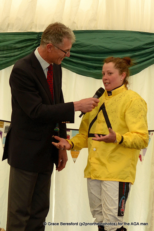 The first race of the evening was the inaugural Subaru Restricted final, which was won by Claire Hart and Dabinett Moon. Claire was whisked away from the winners enclosure and gave a great interview in the AGA marquee, still mud spattered and in her silks, Carl Evans asked the questions!