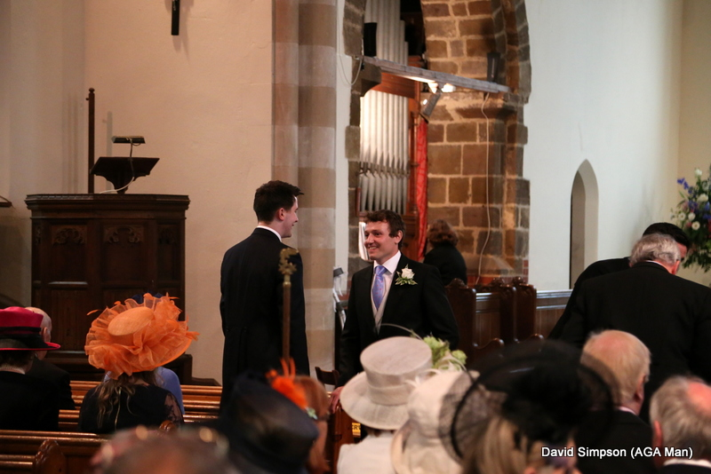 The church is filling up with nice hats and the groom is looking a little nervous!
