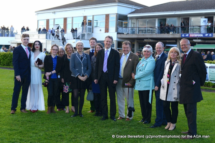 The AGA guests line up for a photo call in the parade ring before the AGA final
