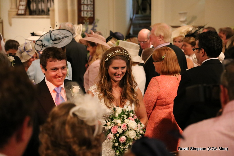 The happy couple leave the church, although the monsoon outside ensured that they weren't gone for long!