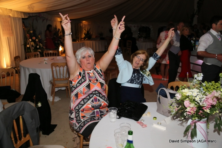 The mothers are still going strong, but they have decided to dance in their seats for the rest of the night!
