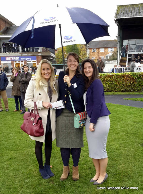 Under the rather smart Subaru umbrella are, L-R: Lucy Wheeler, Steph Holmes and Cara O'Reilly